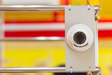 The CCTV security camera operating in the goldshop. Stock Photo