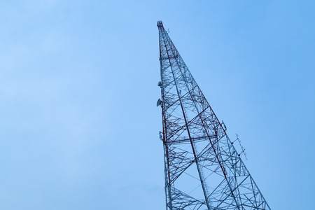 Signal communication tower on blue sky background.