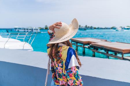 Beautiful woman looking sea view, maldives island background. Stock Photo