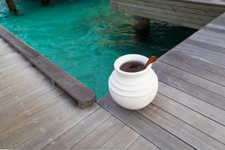 Beautiful tropical Maldives island summer vacation with white jar on wood floor villa in luxury resport.