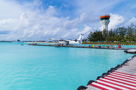 Airplane port on sea ocean background, at maldives.