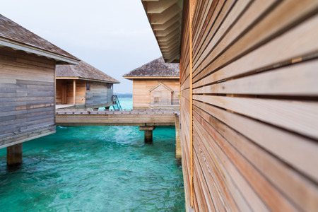Beautiful tropical Maldives island summer vacation relaxing at overwater villa in luxury resport. Stock Photo