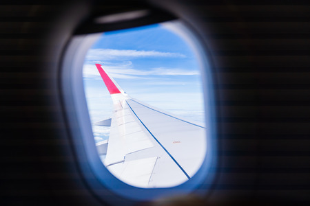 Beautiful blue sky view outside window airplane.