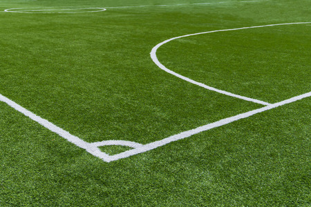 New green glass football field, sport concept background.
