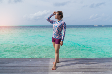 Asian beautiful woman enjoyful traveling sea background; vacation holiday concepts with tropical Maldives island background.