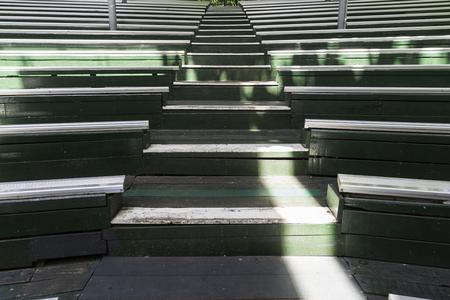 The old wood seat on stadium background. Imagens