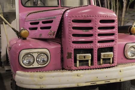 Close up, Vintage pink truck design, old car detail background.
