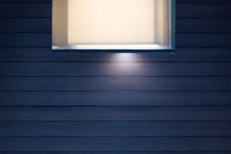 Modern square style decoration lamp and lampshades against dark blue wood wall.
