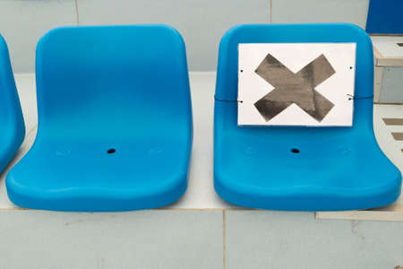 Marking on empty chair without nobody sitting on it. Keep spaced between each chairs make separate for social distancing to avoid spreading of Covid-19. Social distance concept.