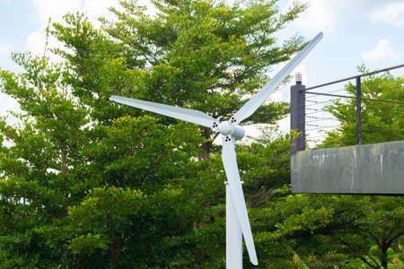 Wind turbine, renewable energy source of future, on blue sky background.