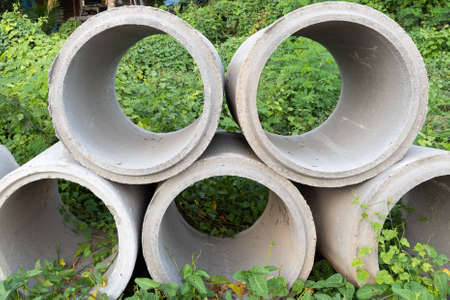 Close up. Concrete pipes used for drainage and road side in a big city.