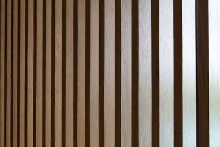 Close up. Seamless pattern of modern wall covering with light brown wooden slats. Background interior design. 版權商用圖片 - 155535756