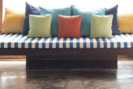 Close up. Colorful sofa and pillow, modern style. Фото со стока