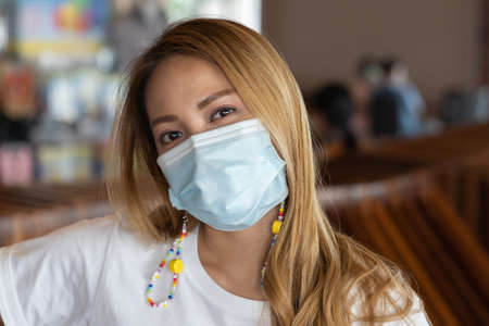 Asian woman with surgical mask face protection.