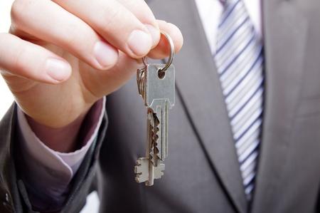 man holding keys Stock Photo