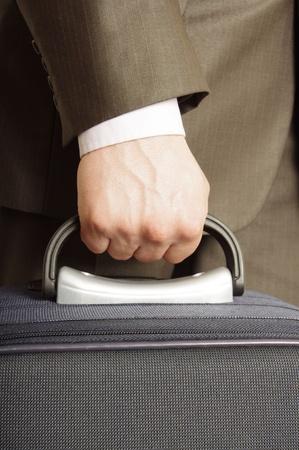 man holding luggage