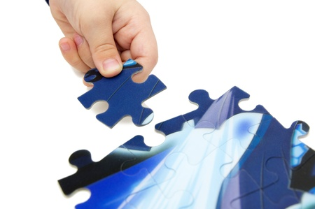 child solving puzzle Stock Photo