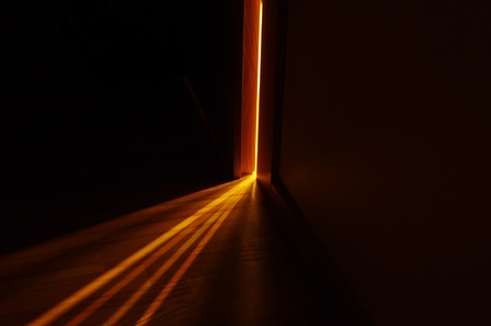 shining light: light shining on the floor through door gap