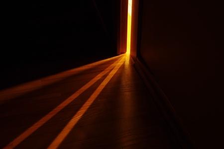 room door: light shining on the floor through door gap