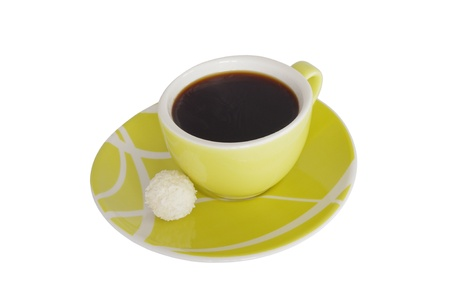 a cup of coffe with a sweet on white background