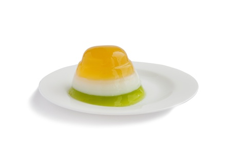 three color jelly on white plate