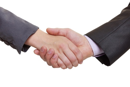partners shaking hands over a deal on white background photo