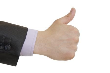 a suited man holding thumbs up on white background