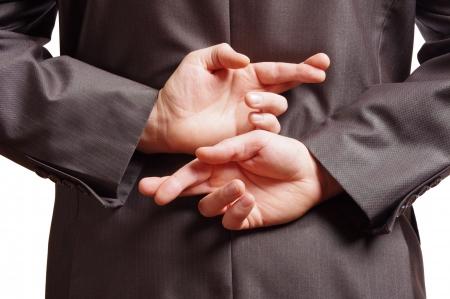 deceptive: vingers gekruist achter een geschikt achterzijde