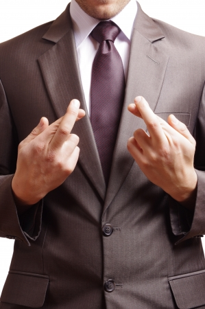 fingers crossed at the front of a suited man Stock Photo - 20354195
