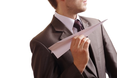 suited man holding a paper plane