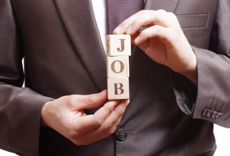 businessman holding a word job made of wooden blocks