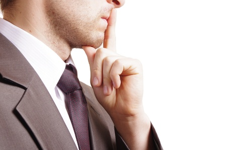 suited man with a gesture of shh on white background Stock Photo - 20354190