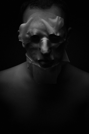 Halloween ???  mask on a dark background in the studio