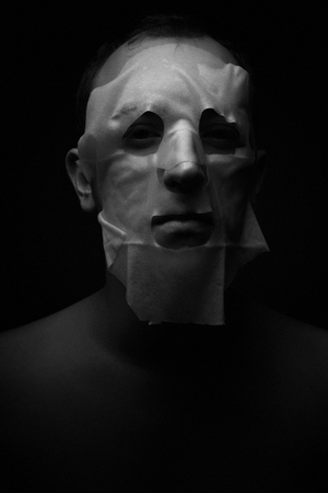 Halloween mask on a dark background in the studio