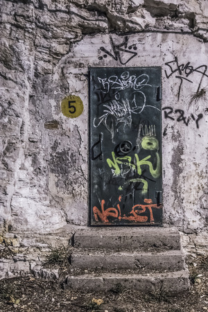 Graffiti on the door of a bunker