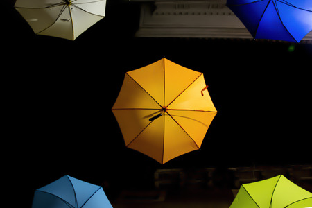 Colorful umbrellas suspended in the air