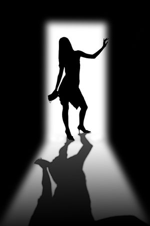 Silhouette of the young girl in a doorway