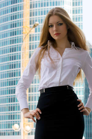 Businesswoman on a background of a under construction skyscraper photo