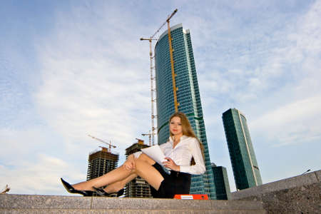 Businesswoman on a background of a under construction skyscraper Stock Photo - 1492250