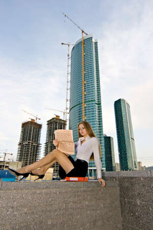 Businesswoman on a background of a under construction skyscraper Stock Photo - 1492200