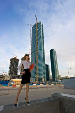 Businesswoman on a background of a under construction skyscraper Stock Photo - 1492198