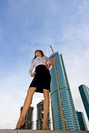 Businesswoman on a background of a under construction skyscraper