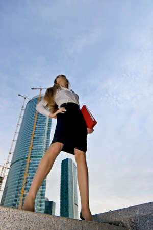 Businesswoman on a background of a under construction skyscraper Stock Photo - 1492197