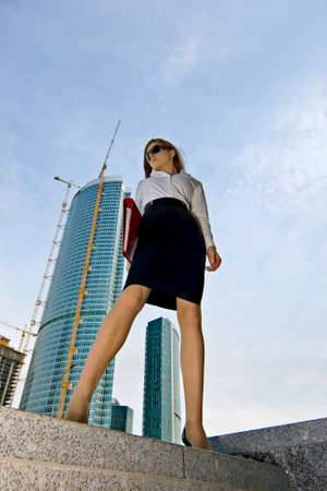 Businesswoman on a background of a under construction skyscraper Stock Photo - 1492202