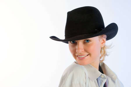 Portrait of young beautiful woman in a hat  photo