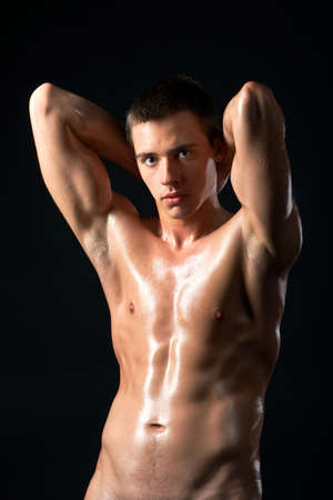 The beautiful young man with the exposed torso photo