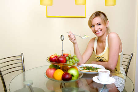 The beautiful girl has breakfast Stock Photo