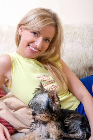 Young women plays with a puppy of a terrier photo