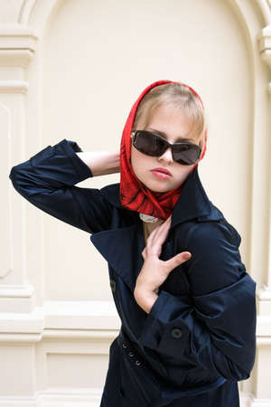 Portrait of the elegant girl in a red scarf photo