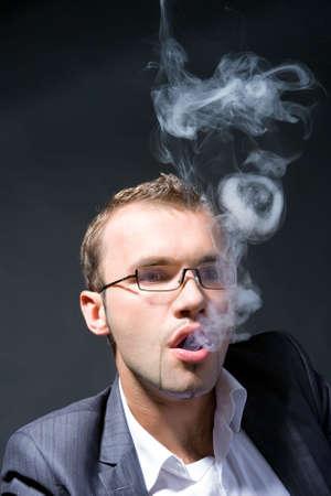 Portrait of a businessman smoking a cigar photo